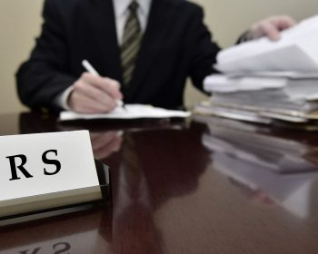 sample-stock-photo-irs-tax-auditor-man-with-a-stern-or-mean-expression-small-2